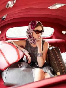 Glamorous model with LV luggage in car